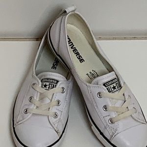 White Converse sneakers.